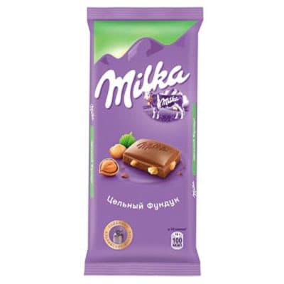 Шоколад Milka молочный с цельным фундуком 90 гр фото