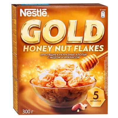 Хлопья Nestle Gold Flakes хрустящие кукурузные с медом и арахисом 300 гр фото